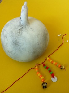 white gourd + necklace - shekere being made