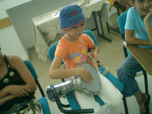 little girl plays darbuka